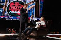 <p>Goodell shared a moment with one of the lucky fans reclining in the commissioner's chair, which featured heavily during the 2020 virtual NFL Draft amid the start of the COVID-19 pandemic.</p>