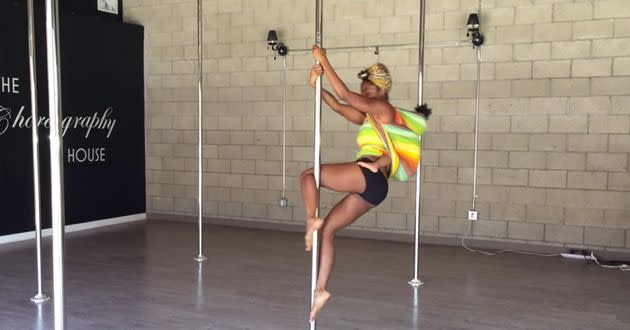 One mother has sparked controversy for pole dancing with her baby strapped to her back. Photo: Youtube