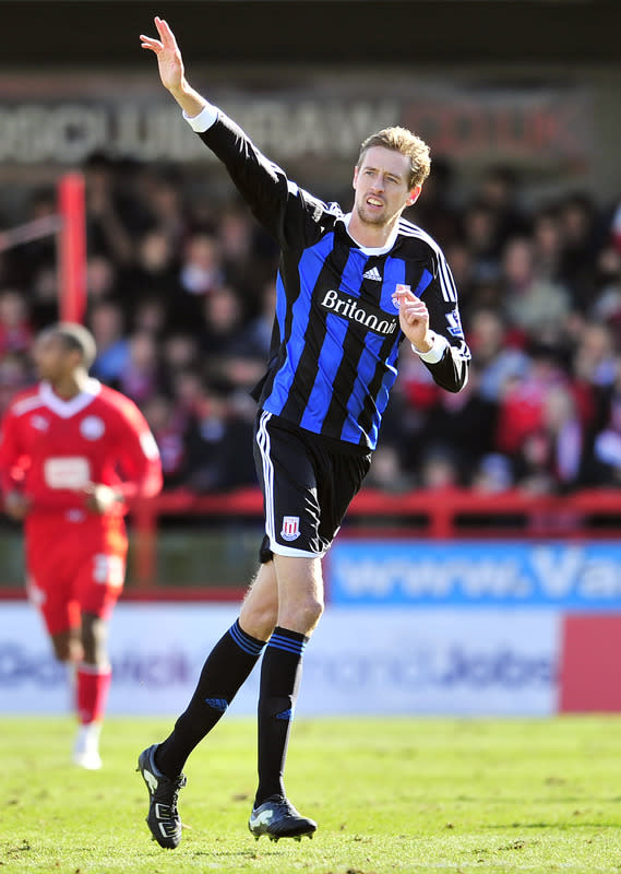 "Stoke City's English striker Peter Crouch celebrates scoring their second goal during their FA Cup fifth round football match against Crawley Town at Broadfield Stadium in Crawley, England on February 19, 2012. RESTRICTED TO EDITORIAL USE. No use with unauthorized audio, video, data, fixture lists, club/league logos or ""live"" services. Online in-match use limited to 45 images, no video emulation. No use in betting, games or single club/league/player publications. (Photo by Glyn Kirk/AFP/Getty Images)"