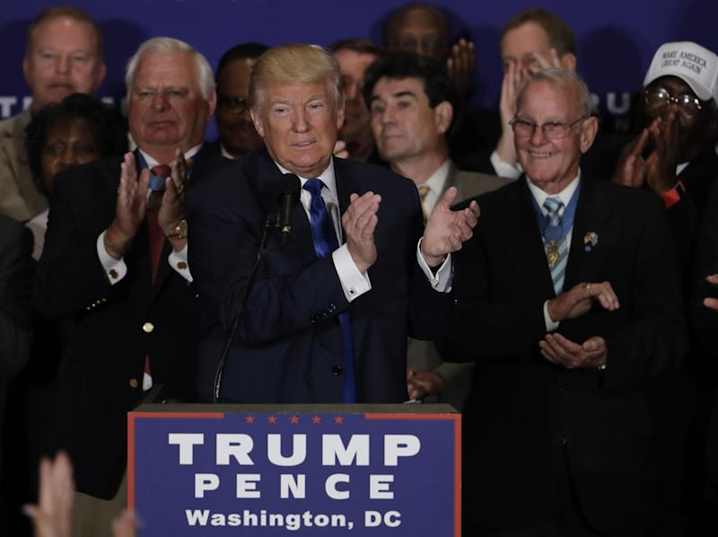 Republican presidential candidate Donald Trump leads the crowd in an applause, recognizing a Gold Star mother in the crowd during a gathering with military leaders and veterans at the new Trump International Hotel in Washington, Friday, Sept. 16, 2016. (AP Photo/Manuel Balce Ceneta)