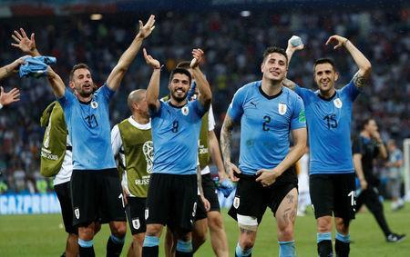 Soccer Football - World Cup - Round of 16 - Uruguay vs Portugal - Fisht Stadium, Sochi, Russia - June 30, 2018 Uruguay's Luis Suarez, Jose Gimenez and team mates celebrate after the match REUTERS/Murad Sezer