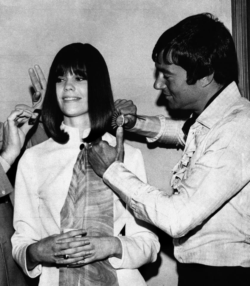 FILE - In this March 30, 1969 file photo, hair stylist Vidal Sassoon displays his talent on a model at a session of hairdressers in Little Rock, Ark. Sassoon, whose 1960s wash-and-wear cuts freed women from endless teasing and hairspray died Wednesday, May 9, 2012, at his home. He was 84. (AP Photo, file)