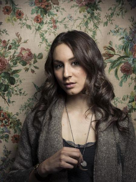 """FILE - This Man. 21, 2013 file photo shows actress Troian Bellisario during the 2013 Sundance Film Festival at the Fender Music Lodge in Park City, Utah. Bellisario's two most recent roles have her playing two women at very different times in their lives who've reached their breaking point and are trying to move forward. She stars on the series """"Pretty Little Liars"""" on ABC Family which is the network's most popular show, and she plays the title role on the Web series """"Lauren"""" for the WIGS YouTube channel. (Photo by Victoria Will/Invision/AP, file)"""