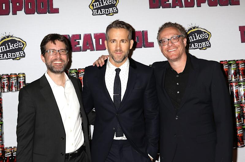 "NEW YORK, NY - FEBRUARY 08: Rhett Reese, Ryan Reynolds and Paul Wernick attend ""Deadpool"" Fan Event at AMC Empire Theatre on February 8, 2016 in New York City. (Photo by Laura Cavanaugh/FilmMagic)"
