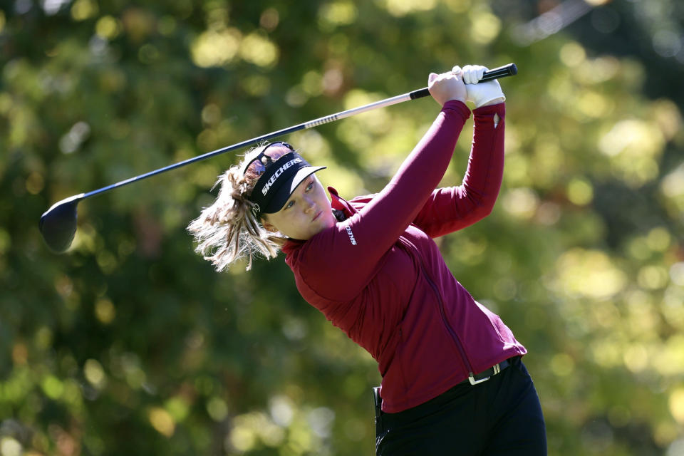 Brooke Henderson, of Canada, watches her tee shot on 14th hole during the first round of the LPGA Cambia Portland Classic golf tournament in Portland, Ore., Thursday, Sept. 16, 2021. (AP Photo/Steve Dipaola)