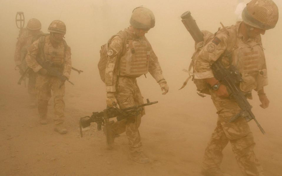 British soldiers from B Company, 2 Mercian, set off on an operation in Malgir, Helmand province July 27, 2009. - Reuters
