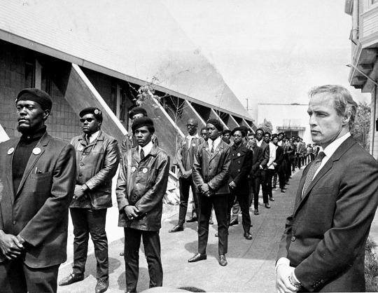 """<p>By the late '60s, the Panthers were not only target No. 1 of the FBI and the government — which tried every tactic at its disposal to destroy them, from informers and divide-and-conquer to arrests and all-out raids — they were also the darlings of the liberal white left. Celebs including actor Marlon Brando, above, composer and conductor Leonard Bernstein, and a young, shag-haired Jane Fonda (<a href=""""http://www.alamy.com/stock-photo-huey-newton-black-panther-party-minister-of-defense-@-news-confrence-32372549.html"""">here's Huey Newton</a>in her apartment in 1970) threw fundraisers for the Panthers in their posh New York City homes, leading to writer Tom Wolfe's now-famous 1970 article in <i>New York </i>magazine, """"<a href=""""http://nymag.com/news/features/46170/"""">Radical Chic</a>,""""which viciously lampooned rich, white liberals for supporting black anticapitalist militants. (<i>Photo: Getty Images)</i></p>"""