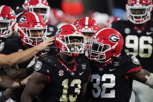 Georgia linebacker Azeez Ojulari (13) celebrates with teammates after a sack during the second half of the team's NCAA college football game against Mississippi State, Saturday, Nov. 21, 2020, in Athens, Ga. (AP Photo/Brynn Anderson)