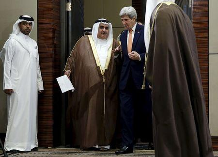 Bahrain's Foreign Minister Sheikh Khalid bin Ahmed Al Khalifa (2nd L) and U.S. Secretary of State John Kerry (R) arrive to speak to reporters ahead of the Gulf Cooperation Council (GCC) Ministerial meeting in Manama, Bahrain April 7, 2016. REUTERS/Jonathan Ernst