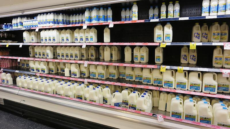 Coles shelves are low on branded milk stock as consumers purchase more expensive brands in support of local farmers on May 24, 2016. Image: Getty