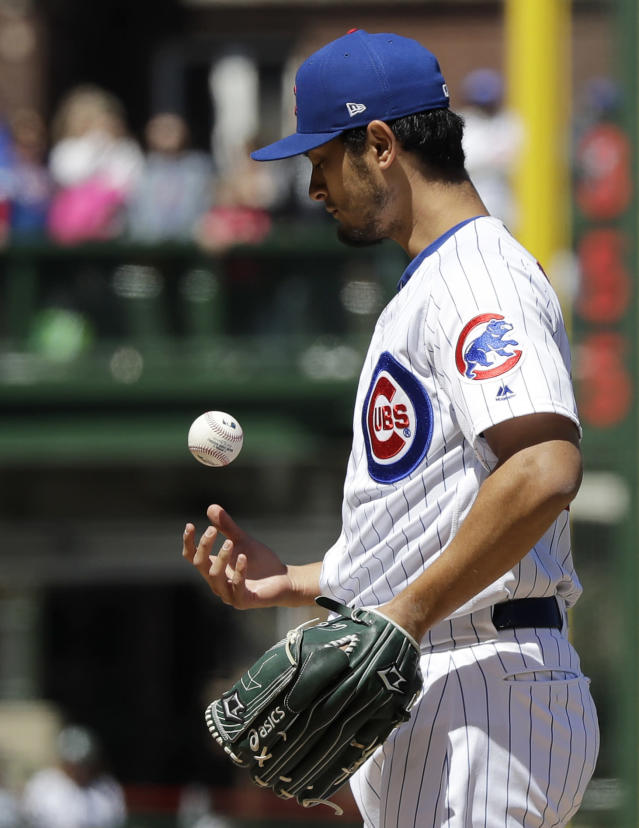 Chicago Cubs starting pitcher Yu Darvish, of Japan, tosses the ball during the first inning of a baseball game against the Arizona Diamondbacks, Saturday, April 20, 2019, in Chicago. (AP Photo/Nam Y. Huh)