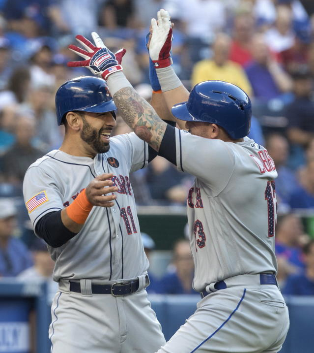 New York Mets' Asdrubal Cabrera, right, celebrates with teammate Jose Bautista after Cabrera hit a two-run home run against the Toronto Blue Jays during the first inning of a baseball game Tuesday, July 3, 2018, in Toronto. (Fred Thornhill/The Canadian Press via AP)