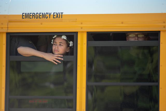 <p>Evacuated middle school students wait on a bus outside Noblesville High School after a shooting at Noblesville West Middle School on May 25, 2018 in Noblesville, Ind. (Photo: Kevin Moloney/Getty Images) </p>