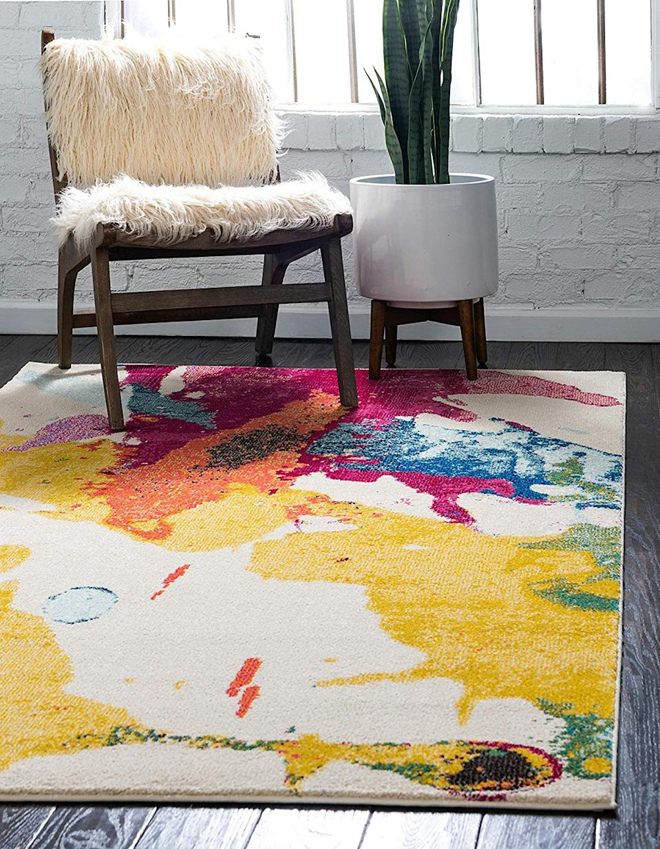 """<a href=""""https://www.amazon.com/Unique-Loom-Estrella-Collection-Colorful/dp/B00RDYPBUK/ref=sr_1_3"""" rel=""""nofollow noopener"""" target=""""_blank"""" data-ylk=""""slk:Unique Loom Abstract Statement Rug"""" class=""""link rapid-noclick-resp""""><h3>Unique Loom Abstract Statement Rug<br></h3></a><br>If you can't decide on one color, go for them all with this abstract area rug that has warm shades of cream, gold, orange, navy blue, and purple. It's bound to make a statement no matter where in your home you decide to put it.<br><br><strong>Unique Loom</strong> Colorful Abstract Area Rug, $, available at <a href=""""https://www.amazon.com/dp/B016WTE1QG"""" rel=""""nofollow noopener"""" target=""""_blank"""" data-ylk=""""slk:Amazon"""" class=""""link rapid-noclick-resp"""">Amazon</a>"""