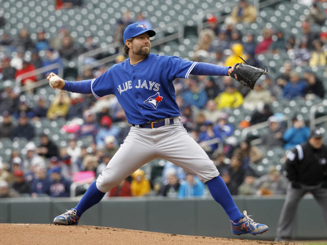 Toronto Blue Jays starting pitcher R.A. Dickey delivers to the Minnesota Twins during the first inning of the first baseball game of a doubleheader in Minneapolis, Thursday, April 17, 2014. (AP Photo/Ann Heisenfelt)