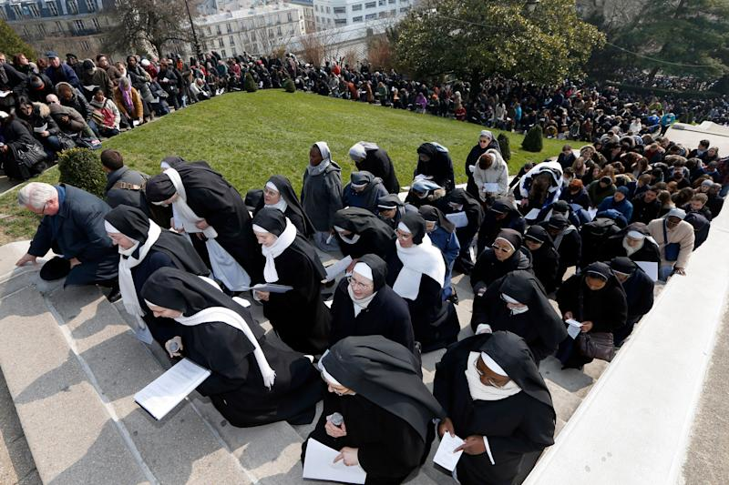 "Catholic nuns attend the annual Good Friday ""Stations of the Cross"" procession in the gardens of the Montmartre's Sacre Coeur Basilica in Paris in March 2013.  (Photo: Charles Platiau / Reuters)"