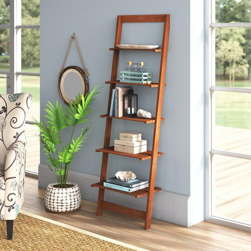 "<h2>Wabansia Ladder Bookcase<br></h2><br><strong>Discount:</strong> 50% off<br><br><strong>The Hype: </strong>4 out of 5 stars and 236 reviews<br><br><strong>Deal Hunters Say: </strong>""Easy to put together, meets online expectations, and is a great size if you need storage that takes up a small amount of space.""<br><br><em>Shop</em> <a href=""https://fave.co/2UAAsw7"" rel=""nofollow noopener"" target=""_blank"" data-ylk=""slk:Highland Dunes"" class=""link rapid-noclick-resp""><strong><em>Highland Dunes</em></strong></a><br><br><strong>Highland Dunes</strong> Wabansia Ladder Bookcase, $, available at <a href=""https://go.skimresources.com/?id=30283X879131&url=https%3A%2F%2Ffave.co%2F2UwUZBQ"" rel=""nofollow noopener"" target=""_blank"" data-ylk=""slk:Wayfair"" class=""link rapid-noclick-resp"">Wayfair</a>"