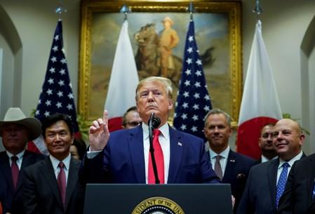 FILE PHOTO: U.S. President Donald Trump speaks about Syria and Turkey during signing ceremony for the U.S.-Japan Trade Agreement at White House in Washington