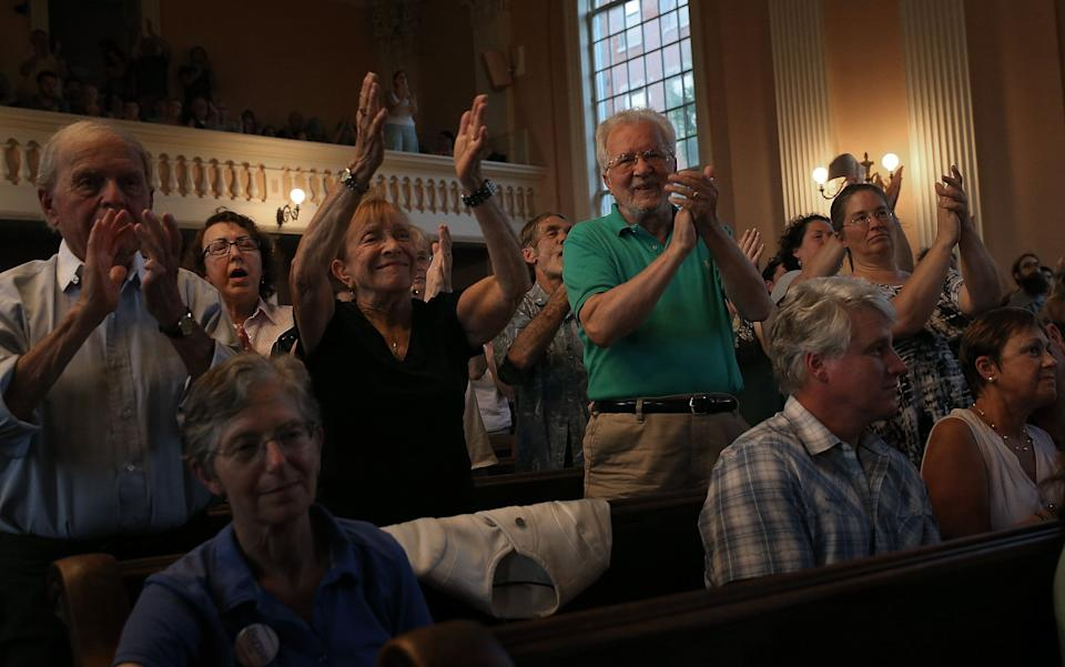 Sen. Bernie Sanders receives a standing ovation while speaking at a town meeting at the South Church on May 27, 2015 in Portsmouth, New Hampshire.