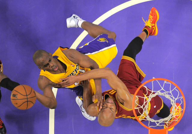 Los Angeles Lakers guard Jodie Meeks, left, puts up a shot as Cleveland Cavaliers guard Jarrett Jack defends during the first half of an NBA basketball game, Tuesday, Jan. 14, 2014, in Los Angeles. (AP Photo/Mark J. Terrill)