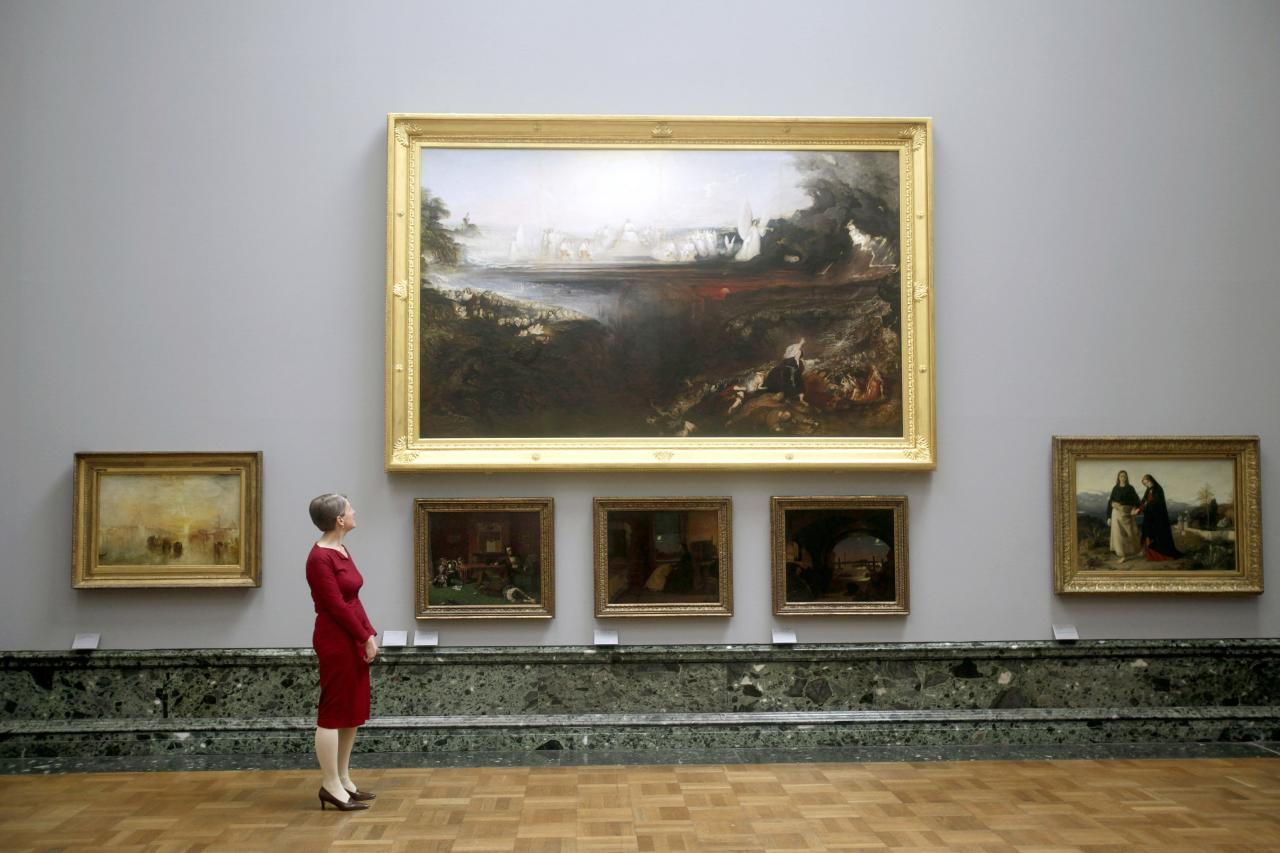 LONDON, UNITED KINGDOM - MAY 13: Penelope Curtis, Director ofTate Britain, standing next to the painting by John Martin The Last Judgement 1853 on display at the Walk through British Art exhibition at Tate Britain on May 13, 2013 in London, England. Visitors will experience a completely new presentation of the world's greatest collection of British art, the national collection of British art will be displayed in a continuous and purely chronological display from the 1500s to the present day. (Photo by Warrick Page/Getty Images)