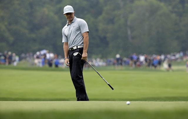 Rory McIlroy, of Northern Ireland, reacts after his chip to the fourth green during the second round of the PGA Championship golf tournament at Valhalla Golf Club on Friday, Aug. 8, 2014, in Louisville, Ky. (AP Photo/John Locher)