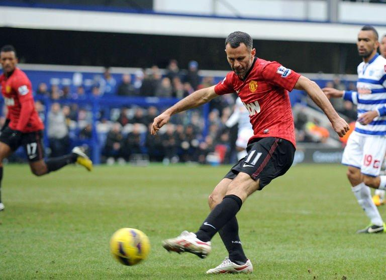Manchester United Ryan Giggs scores against QPR at Loftus Road in London on February 23, 2012