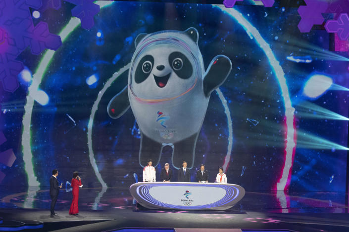 """FILE - In this Sept. 17, 2019, file photo, Bing Dwen Dwen, the official mascot for the 2022 Beijing Winter Olympic is revealed at a ceremony at the Shougang Ice Hockey Arena in Beijing. Groups alleging human-rights abuses in China are calling for a full boycott of the Beijing Olympics, which is sure to ratchet up pressure on the International Olympic Committee, athletes, sponsors, and sports federations. A coalition of activists representing Uyghurs, Tibetans, residents of Hong Kong and others, issued a statement Monday, May 17, 2021 calling for the """"full boycott,"""" eschewing lesser measures like """"diplomatic boycotts"""" and negotiations with the IOC or China. (AP Photo/Ng Han Guan, File)"""