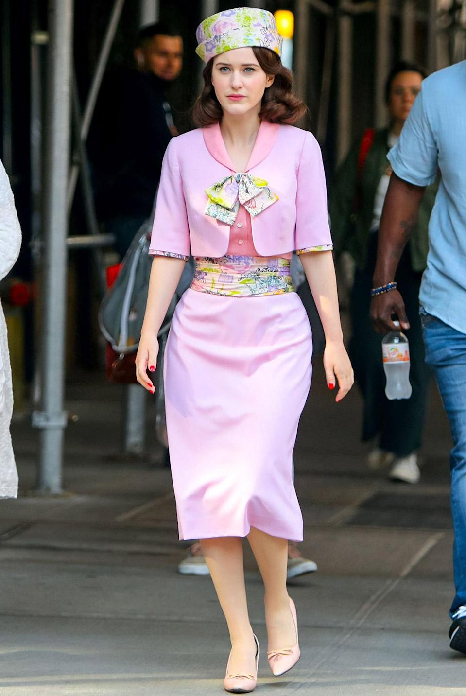 <p>Brosnahan sports a pink floral ensemble with a matching hat while filming on June 1. </p>