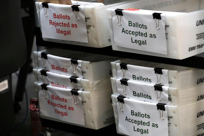 Boxes for illegal and legal vote-by-mail ballots are shown as the the Miami-Dade County canvassing board meets to verify signatures on vote-by-mail ballots for the Aug. 18 primary election at the Miami-Dade County Elections Department in Doral, Fla. on July 30, 2020.