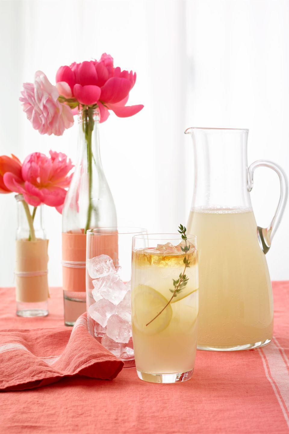 <p>Make a vase for your Mother's Day brunch table! Fold tissue paper and affix to a bottle with double-sided tape, then wrap in twine and fill with flowers.</p>