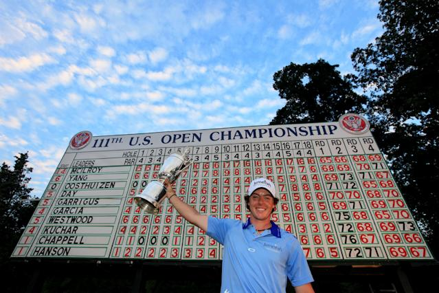 BETHESDA, MD - JUNE 19: Rory McIlroy of Northern Ireland poses with the trophy after his eight-stroke victory on the 18th green during the 111th U.S. Open at Congressional Country Club on June 19, 2011 in Bethesda, Maryland. (Photo by David Cannon/Getty Images)