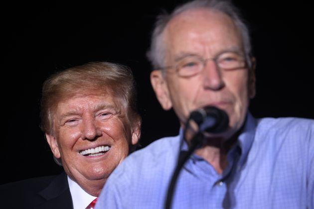 Former President Donald Trump smiles as Sen. Chuck Grassley (R-Iowa) speaks during a rally at the Iowa State Fairgrounds on Oct. 9 in Des Moines. Trump endorsed Grassley for reelection at the event. (Photo: Scott Olson via Getty Images)