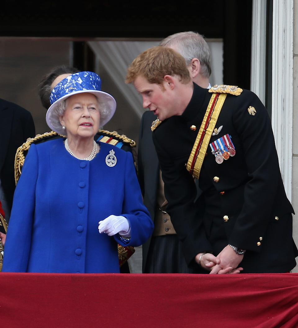 LONDON, ENGLAND - JUNE 15:  Prince Harry chats to Queen Elizabeth II on the balcony of Buckingham Palace during the annual Trooping the Colour Ceremony on June 15, 2013 in London, England. Today's ceremony which marks the Queens official birthday will not be attended by Prince Philip the Duke of Edinburgh as he recuperates from abdominal surgery and will also be The Duchess of Cambridge's last public engagement before her baby is due to be born next month.  (Photo by Chris Jackson/Getty Images)