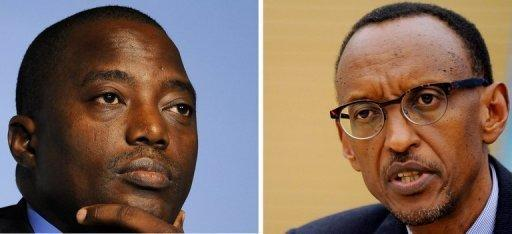 Kabila (left) and Kagame (right) held a two-hour meeting on Tuesday, Uganda's foreign minister told AFP