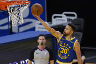 Golden State Warriors guard Stephen Curry (30) shoots against the New York Knicks during the first half of an NBA basketball game in San Francisco, Thursday, Jan. 21, 2021. (AP Photo/Jeff Chiu)