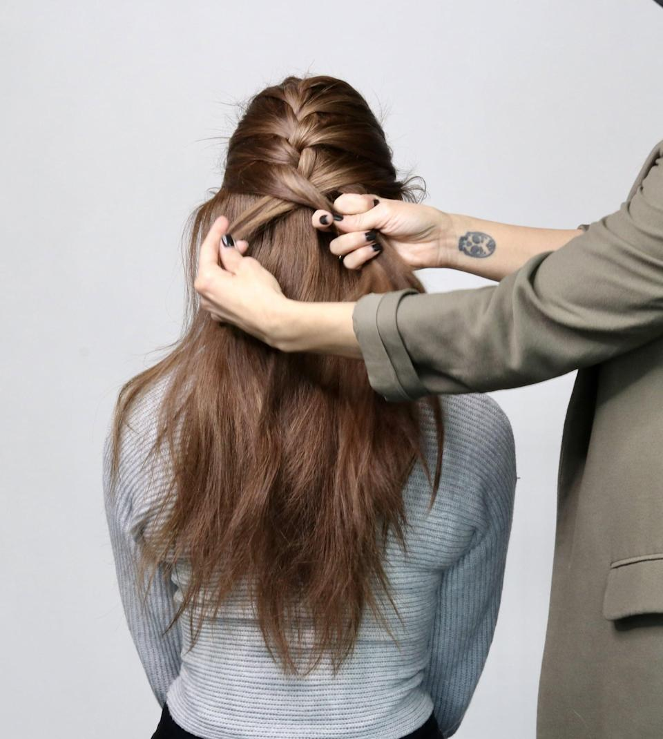 "<p>""Once you have crossed the two sections on the side, you then want to attach the style to the scalp by incorporating small sections of hair on the side near the front of the hairline back to the braid, rotating left to right,"" Strebe said.</p>"