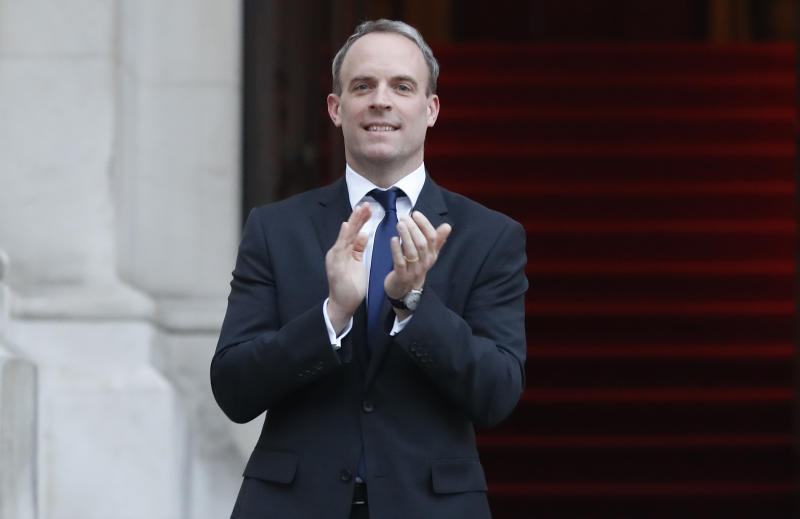 """LONDON, UNITED KINGDOM - APRIL 23: Foreign Secretary, Dominic Raab takes part in """"Clap For Carers"""" outside the Foreign Office on April 23, 2020 in London, United Kingdom. Following the success of the """"Clap for Our Carers"""" campaign, members of the public are being encouraged to applaud NHS staff and other key workers from their homes at 8pm every Thursday. The Coronavirus (COVID-19) pandemic has infected over 2.5 million people across the world, claiming at least 18,738 lives in the U.K. (Photo by Frank Augstein - WPA Pool/Getty Images)"""