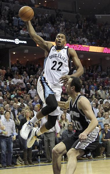 FILE - In this Jan. 11, 2013, file photo, Memphis Grizzlies forward Rudy Gay (22) goes to the basket over San Antonio Spurs guard Manu Ginobili, of Argentina, during the second half of an NBA basketball game in Memphis, Tenn. A person with knowledge of the deal tells The Associated Press themphis Grizzlies have agreed to trade Gay to the Toronto Raptors. The Raptors gave up point guard Jose Calderon in the deal, though it appears he is headed to a third team other than the Grizzlies, the person said. The person spoke on the condition of anonymity because the deal had not yet been announced. (AP Photo/Lance Murphey, File)