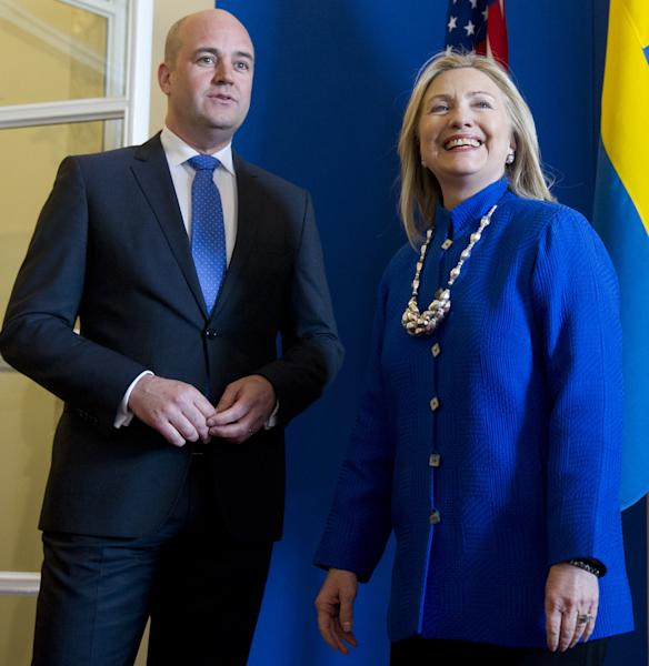 Swedish Prime Minister Fredrik Reinfeldt, left, greets US Secretary of State Hillary Rodham Clinton as she arrives for meetings at Rosenbad in Stockholm, Sweden, Sunday, June 3, 2012. (AP Photo/Saul Loeb, Pool)