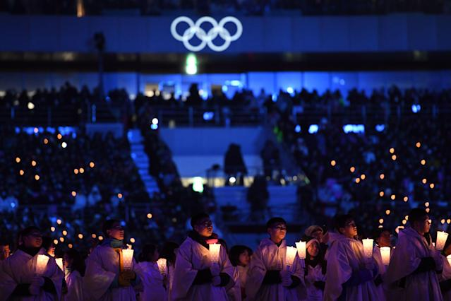 <p>Actors hold candles during the opening ceremony of the Pyeongchang 2018 Winter Olympic Games at the Pyeongchang Stadium on February 9, 2018. / AFP PHOTO / Kirill KUDRYAVTSEV </p>
