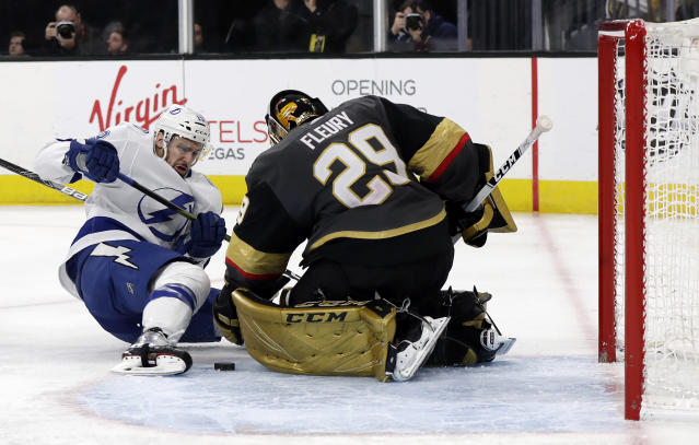 Tampa Bay Lightning forward Cedric Paquette shoots as Vegas Golden Knights goalie Marc-Andre Fleury defends during the third period of an NHL hockey game Thursday, Feb. 20, 2020, in Las Vegas. The Golden Knights won 5-3. (AP Photo/Isaac Brekken)