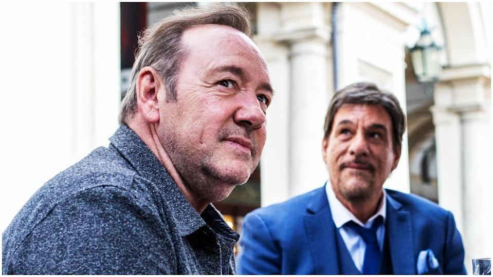 Kevin Spacey takes a break during filming in Turin, Italy. - Credit: AP