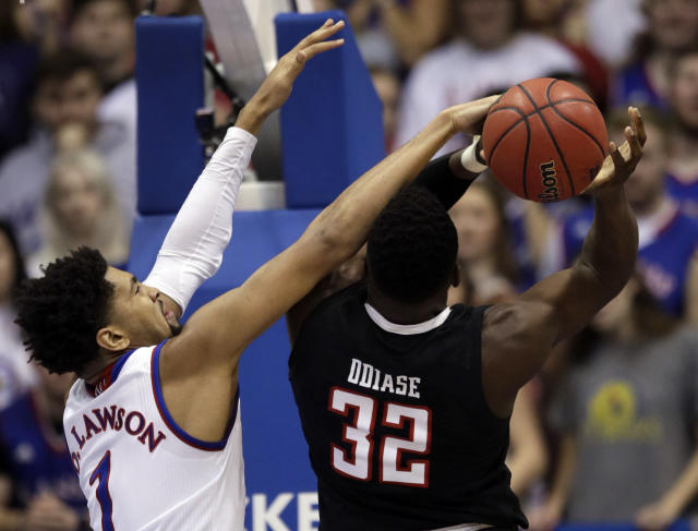 Kansas forward Dedric Lawson (1) blocks a shot by Texas Tech center Norense Odiase (32) during the first half of an NCAA college basketball game in Lawrence, Kan., Saturday, Feb. 2, 2019. (AP Photo/Orlin Wagner)