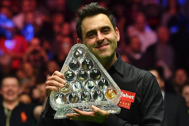 England's Ronnie O'Sullivan poses with the trophy after winning the Masters in London in January 2017 (AFP Photo/Ben STANSALL)