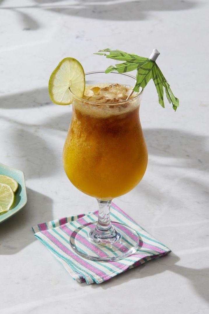 """<p>Passion fruit puree and ginger liqueur make this tropical cocktail a delicious addition to any summer party.</p><p><em><a href=""""https://www.goodhousekeeping.com/food-recipes/a28579740/passion-fruit-mai-tai-recipe/"""" rel=""""nofollow noopener"""" target=""""_blank"""" data-ylk=""""slk:Get the recipe for Passion Fruit Mai Tai »"""" class=""""link rapid-noclick-resp"""">Get the recipe for Passion Fruit Mai Tai »</a></em><br></p>"""