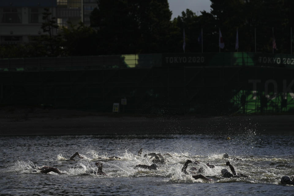Swimmers compete in the women's marathon swimming event at the 2020 Summer Olympics, Wednesday, Aug. 4, 2021, in Tokyo, Japan. (AP Photo/Jae C. Hong)