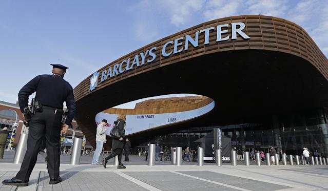 A police officer patrols the area in front of the Barclays Center in New York, Monday, April 15, 2013, before a Brooklyn Nets NBA basketball game in the wake of the explosions at the Boston Marathon. (AP Photo/Kathy Willens)