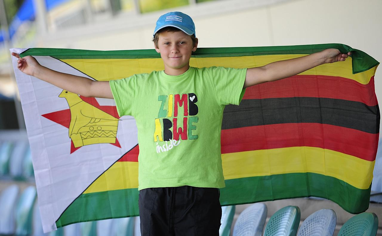 TOWNSVILLE, AUSTRALIA - AUGUST 14:  Jason Burl shows his support for Zimbabwe during the ICC U19 Cricket World Cup 2012 match between India and Zimbabwe at Tony Ireland Stadium on August 14, 2012 in Townsville, Australia.  (Photo by Ian Hitchcock-ICC/Getty Images)