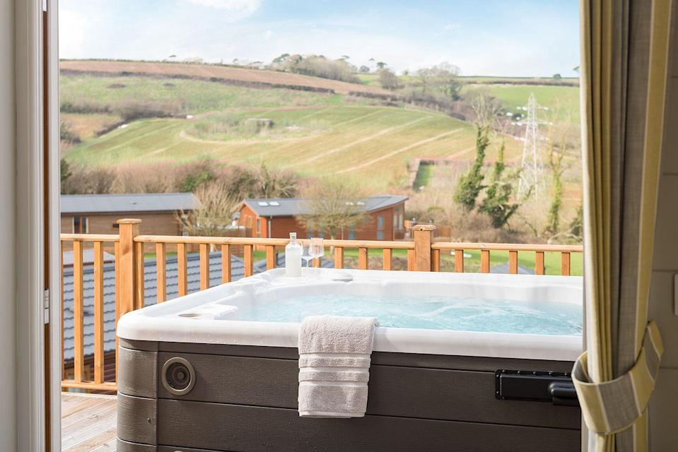 """<p>A traditional escape at a holiday park is the perfect way to treat the kids to the type of staycation you had as a child, giving them plenty of opportunities to be entertained and make new friends. Whatever their age, or if you're travelling without the kids, <a href=""""https://haulfrynholidays.co.uk/our-parks/devon/devon-hills/"""" rel=""""nofollow noopener"""" target=""""_blank"""" data-ylk=""""slk:Haulfryn Holidays' Devon Hills Holiday Park"""" class=""""link rapid-noclick-resp"""">Haulfryn Holidays' Devon Hills Holiday Park</a> offers a luxurious twist to a classic British break.</p><p>Set in the perfect countryside location near Paignton, it offers a terrific base for exploring the Dartmoor National Park, Torquay, Salcombe and more. Here, you can stay in a luxurious lodge with a few treats that go beyond the usual home comforts. Opt for a three-bedroom Fairview Heights lodge, which comes with a hot tub the whole family will love and a cosy kitchen-living space (with a kitchen island). While you'll love having the freedom to cook and relax in a way you can't at a hotel, the Blagdon Inn sits within the holiday park if you fancy pub grub or a few drinks. </p><p>There's also an indoor swimming pool, tennis courts and fitness centre. The best bit? You can bring the dog along to enjoy the pet-friendly holiday park.</p><p><a class=""""link rapid-noclick-resp"""" href=""""https://haulfrynholidays.co.uk/our-parks/devon/devon-hills/"""" rel=""""nofollow noopener"""" target=""""_blank"""" data-ylk=""""slk:CHECK AVAILABILITY"""">CHECK AVAILABILITY</a></p>"""